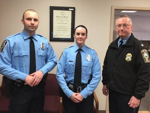 A photo provided by the Prince William County Police Department shows, from the left, Officer Steven Kendall, and Officer Ashley Guindon with Lt. Col. Barry Bernard, deputy chief of the Prince William County, Va., Police Department. Officer Ashley Guindon was shot and killed Saturday, Feb. 28, 2016, and two of her colleagues were wounded in a confrontation stemming from a call about an argument. Guindon and Kendall were sworn in on Friday, and Guindon was working her first shift with the Prince William County Police Department when she was killed. (Prince William County Police Department via AP)