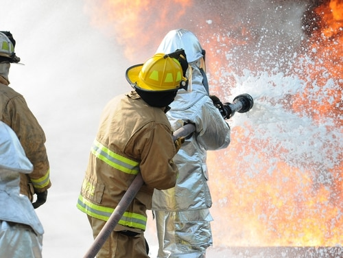 Air Force and New Jersey state fire protection specialists battle a simulated aircraft fire. The Pentagon is looking to mitigate the harm of the toxic chemicals in the firefighting foam. (Airman 1st Class Amber Powell/Air National Guard)