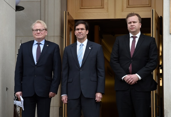 U.S. Defense Secretary Mark Esper, center, welcomes Finnish Defence Minister Antti Kaikkonen, right, and Swedish Defence Minister Peter Hultqvist at the Pentagon on Dec. 10, 2019. (Olivier Douliery/AFP via Getty Images)