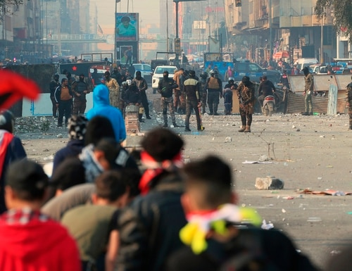 Security forces try to disperse anti-government protesters during clashes in downtown Baghdad, Iraq, Thursday, Jan. 30, 2020. (Hadi Mizban/AP)