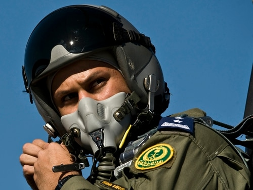 A Royal Saudi air force F-15 Strike Eagle pilot adjusts his flight helmet before a training mission Jan. 25, 2012, at Nellis Air Force Base, Nev. (Senior Airman Brett Clashman/Air Force)