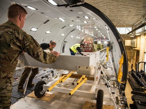Airman 1st Class Nicholas Benson, 344th Air Refueling Squadron boom operator helps instructors guide equipment onto a KC-46 Pegasus fuselage trainer Dec. 4, 2018, at McConnell Air Force Base, Kansas. (Airman 1st Class Alan Ricker/Air Force)