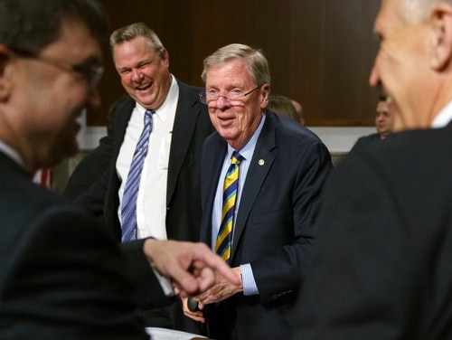 Veterans Affairs Secretary Robert Wilkie, left, and Sen. Thom Tillis, R-N.C., right, talk with Senate Veterans Affairs Committee chairman Johnny Isakson, R-Ga., second from right, and ranking member Sen. Jon Tester, D-Mont., second from left, during a Senate Veterans Affairs Committee hearing on Capitol Hill in June 27, 2018. Lawmakers have grown increasingly frustrated with VA officials over a host of unanswered policy and operations questions. (Carolyn Kaster/AP)