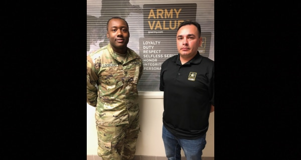 Staff Sgt. Locklear, left, and Staff Sgt. Marl pose for a photo in front of their recruiting offices. (Army)