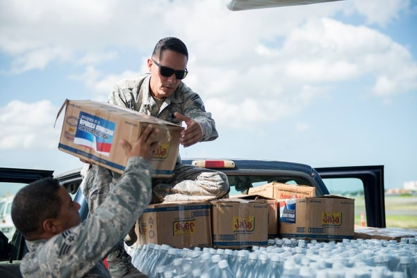 Senior Master Sgt. Jan Paravisini, a maintenance management analyst with the 156th Airlift Wing, loads supplies onto a truck in Isla Grande Airport, Puerto Rico, Nov. 22, 2017, during the recovery effort after Hurricane Maria. Paravisini, of Canovanas, Puerto Rico, was one of nine airmen killed in a WC-130 crash in Savannah, Georgia, on May 2. (Air National Guard/Staff Sgt. Daniel Martinez)