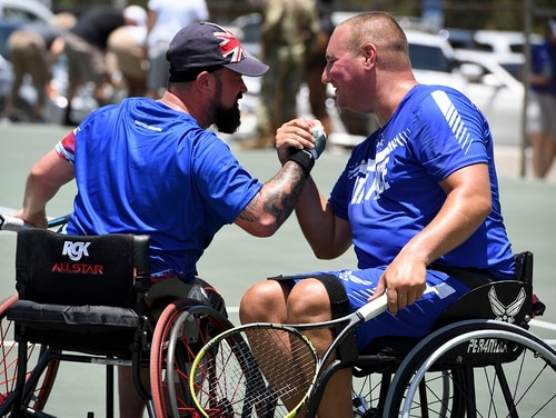 From left: Cpl. John Willans, Team United Kingdom, and Staff Sgt. Brian Biviano celebrate after they won their final match of wheelchair tennis, June 23, 2019, Tampa, Fla. (Staff Sgt. Sahara L. Fales/Air Force)