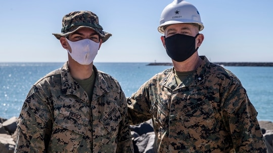 Brig. Gen. Dan Conley, right, the commanding general of Marine Corps Installations West, poses with Cpl. Jordan Perez, a combat engineer with 7th Engineer Support Battalion, 1st Marine Logistics Group, in the 21 Area of Camp Pendleton, California, Feb. 19. (Lance Cpl. Alison Dostie/Marine Corps)