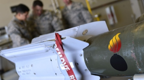 The Pentagon may look to change how it helps buy precision guided munitions for allies. The 432nd Maintenance Squadron munitions flight reviews safety precautions before building six GBU-12 Paveway II laser-guided bombs March 1, 2016, at Creech Air Force Base. (Christian Clausen/Air Force)