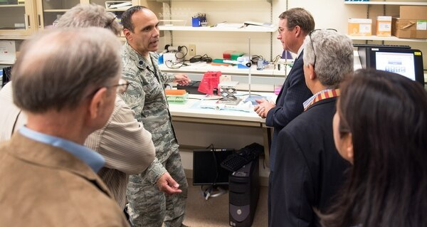 U.S. Air Force Lt. Col. Leonardo Tato, 60th Medical Support Squadron gives a tour to representatives from NASA during meeting with members of the 60th Medical Group at Travis Air Force Base, Calif., June 1, 2018. NASA and David Grant USAF Medical Center are meeting for a potential collaboration between the two organizations to help in future space exploration. (U.S. Air Force photo by Louis Briscese)