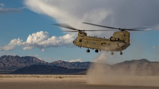 A CH-47F Chinook prepares to land as Oregon Army National Guard pilots from the 1-168th General Support Aviation Battalion perform dust landing certification flights at the National Training Center in Fort Irwin, Calif., on May 29, 2019. (Cpl. Alisha Grezlik/U.S. Army)