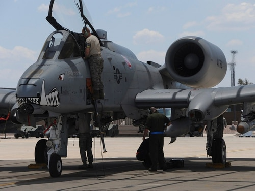 Airmen work on an A-10 Tunderbolt II after its arrival for Hawgsmoke 2016 at Davis-Monthan Air Force Base in Arizona. In November, the base grounded 28 of its 85 A-10s for about a week. (Airman Nathan H. Barbour/Air Force)