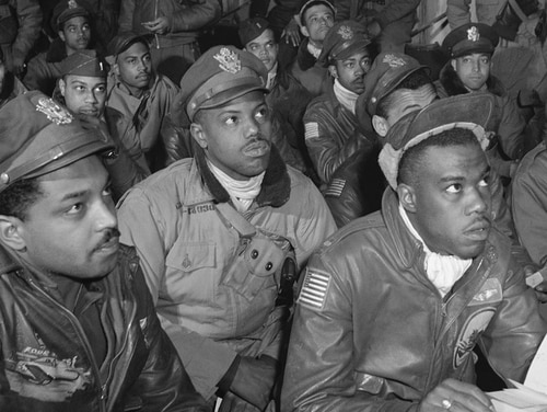 Pilots with the 332nd Fighter Group, the Tuskegee Airmen, attend a briefing in Ramitelli, Italy, in March 1945 during the Second World War. A lot of progress has been made in race relations within the Air Force, but more work remains to be done. (Toni Frissell Collection/Library of Congress)