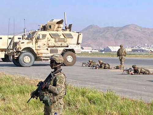 U.S soldiers stand guard along a perimeter at the international airport in Kabul, Afghanistan, Monday, Aug. 16, 2021. (AP Photo/Shekib Rahmani)
