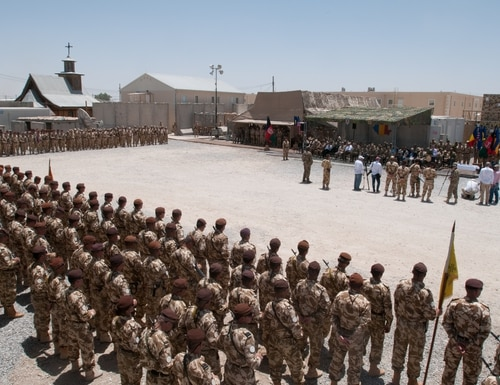 The Romanian 20th Infantry Battalion, Black Scorpions, stand in formation during their end-of-operations ceremony on Kandahar Airfield, Afghanistan, June 29. The Black Scorpions made important routes safe in Regional Command (South) by clearing them of explosives planted by insurgents, a role that has been transitioned to the Afghan National Security Forces. The Romanians will retain a support presence in Afghanistan. (U.S. Army photo by Spc. Ariel J. Solomon)