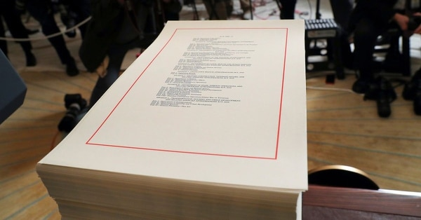 In this March 23, 2018, file photo, a copy of the $1.3 trillion spending bill is stacked on a table in the Diplomatic Room of the White House in Washington. Will Congress be able to pass on the appropriations bills for fiscal 2019 in time? Probably not. (Pablo Martinez Monsivais/AP)