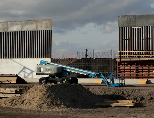 The first panels of levee border wall go up at a construction site along the U.S.-Mexico border, in Donna, Texas. (Eric Gay/AP)