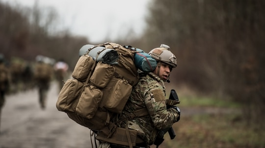 Air Force Tech. Sgt. Andrew Gibson pulls rear security while walking to a rally point Jan. 14, 2020, during exercise Frozen Defender in Grostenquin, France. (Staff Sgt. Devin Boyer/Air Force)