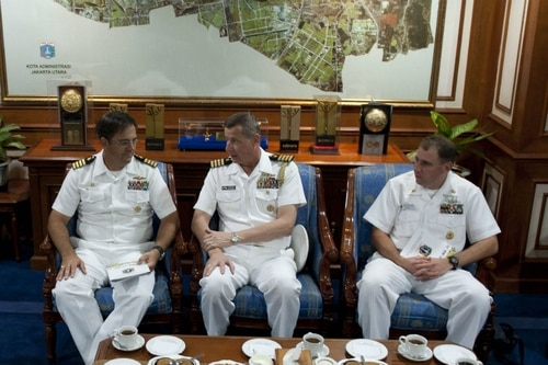 Rear Adm. Adrian Jansen, center, during a meeting in 2012 in Indonesia, where he was serving as naval attaché in the time when the Navy says he took private dinners and wine from