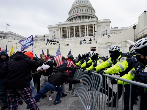 A number of veterans participated in the Jan. 6 storming of the Capitol by supporters of then-President Donald Trump. (AP Photo/Julio Cortez)