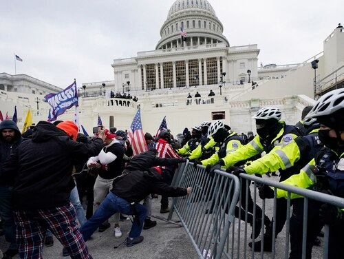 Trump supporters try to break through a police barrier at the Capitol in Washington on Jan. 6, 2021. (Julio Cortez/AP)