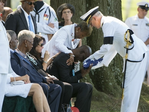Darrold Martni's son, Xavier, was one of seven sailors killed a year ago when the destroyer Fitzgerald collided with a merchant vessel. Here, Martin accepts the American flag at his son's August funeral at Arlington National Cemetery. (Army)