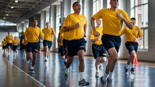 Recruits run sprints during a physical training session at Recruit Training Command at Great Lakes, Illinois, where the first confirmed case of COVID-19 emerged over the weekend. (MC2 Spencer Fling/Navy)