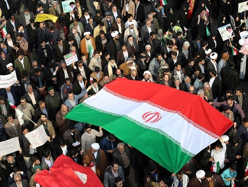 Iran confirmed Wednesday that Michael R. White, a U.S. Navy veteran, is imprisoned in the country. Pictured: Iranian pro-government supporters march during a rally in Mashhad on Jan. 4, 2018, in support of the regime after authorities declared the end of deadly unrest. (Nima Najafzadeh/AFP via Getty Images)