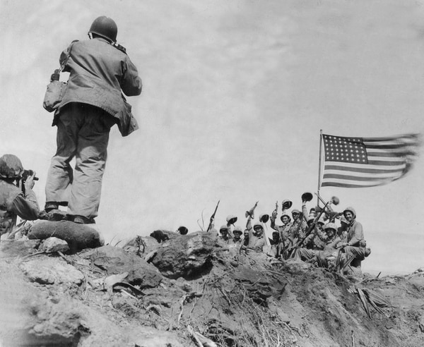 In this Feb 23, 1945, file photo, U.S. Marines of the 28th Regiment, 5th Division, raise the American flag atop Mount Suribachi, Iwo Jima, Japan. (Joe Rosenthal/AP)