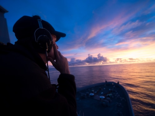 A sailor from the transport dock ship San Diego stands watch on the bridge wing. Former officers are voicing their concerns over the inability of today's SWOs to display knowledge of basic operations and mariner skills. (MC2 Stacy M. Atkins Ricks/Navy)