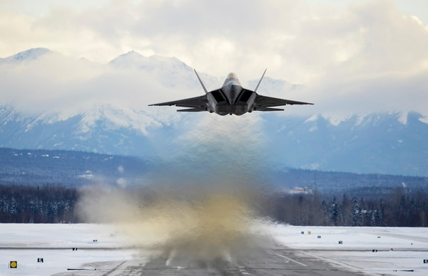 An Air Force F-22 flies over Joint Base Elmendorf-Richardson, Alaska. The reliance on Raptors for homeland defense alert missions detracts from training for high-end air superiority challenges. (Jamal Wilson/Air Force)