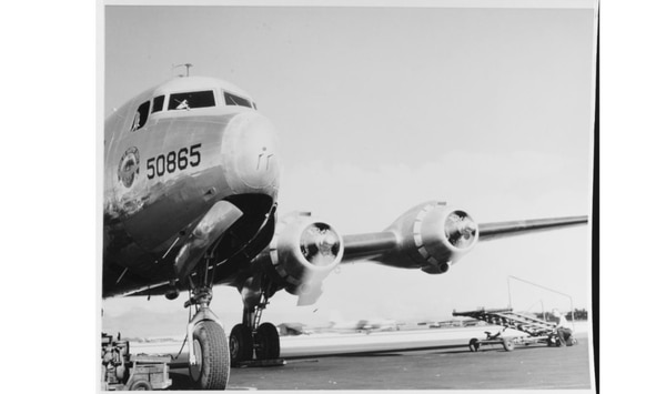 A Douglas R5D-1 Skymaster Transport BUNO 50865 warms up its engines at Hickam Field, Honolulu, Hawaii, in either 1944 or 1945. The plane wears the insignia of the Naval Air Transport Service (NATS). The Skymaster helped usher out the era of the Pan Am Clipper planes. (National Archives)