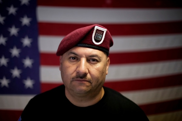 In this Feb. 13, 2017, file photo, U.S. Army veteran Hector Barajas, who was deported, poses for a portrait in his office at the Deported Veterans Support House, nicknamed