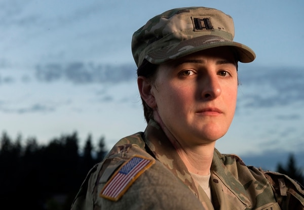 In this photo taken on Aug. 28, 2015, transgender Joint Base Lewis–McChord soldier Capt. Jennifer Peace poses near her home in Spanaway, Wash. The Army has known that Peace is a woman for almost a year but still refers to her as a man. She's awaiting a Pentagon policy change that's expected within the next year that will allow transgender soldiers to serve openly. Peace is a twice-deployed veteran of Iraq and Afghanistan. (Drew Perine/The News Tribune via AP)