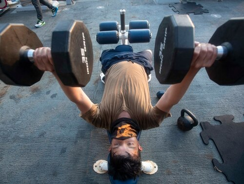 Boatswain's Mate Seaman Apprentice Esau Arellano, assigned to the guided-missile destroyer Ralph Johnson, keeps physically fit while underway on Aug. 4 in the Arabian Gulf. (MC3 Anthony Collier/Navy)