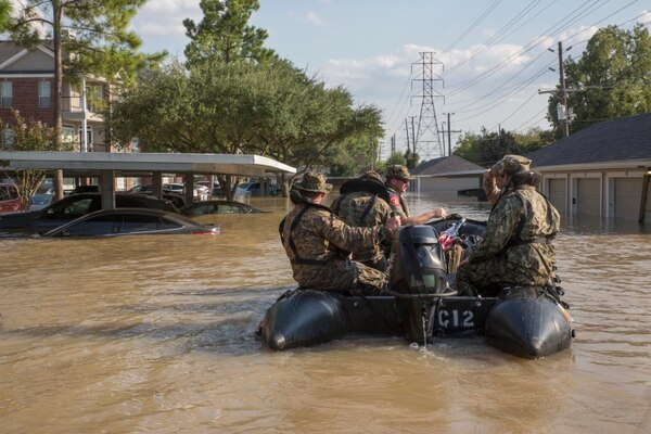Marines navigate through a flooded parking lot in Houston, Texas, Aug. 31. Marine reservists assisted with rescue efforts in the wake of Hurricane Harvey, providing Zodiacs and personnel to local law enforcement. (Lance Cpl. Niles Lee/Marine Corps)