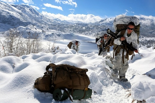 On a frozen battlefield, weapons can be less lethal and more difficult to maintain. (Lance Cpl. Sullivan Laramie/Marine Corps)