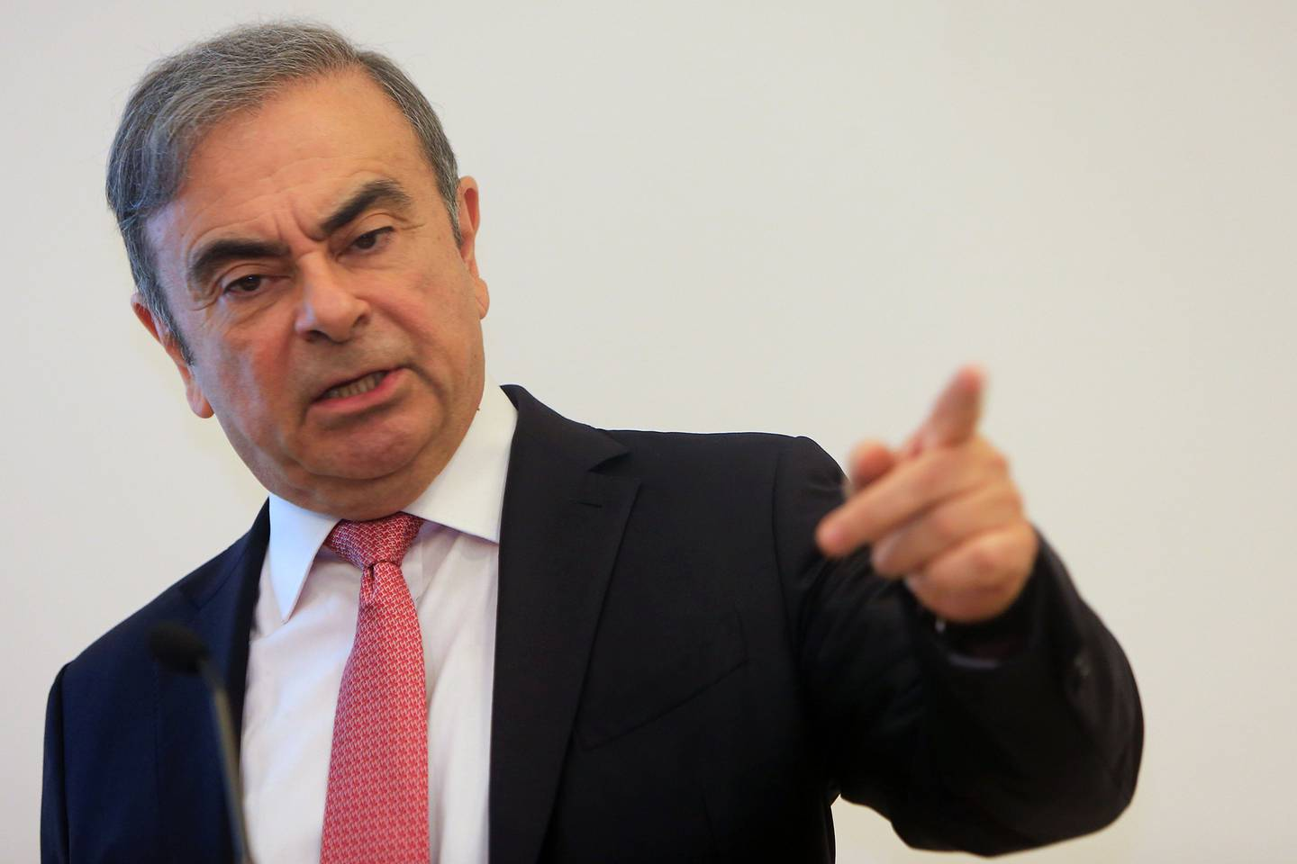 Former Renault-Nissan boss Carlos Ghosn addresses a large crowd of journalists on his reasons for dodging trial in Japan, where he is accused of financial misconduct, at the Lebanese Press Syndicate in Beirut on January 8, 2020.