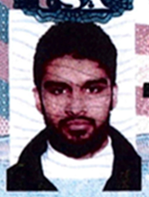 FILE - This undated passport photo provided by the U.S. Attorney's Office in Chicago shows Mohammed Hamzah Khan. Khan, 19, a suburban Chicago youth accused of trying to join Islamic State militants is holding talks about a possible plea deal. Agents arrested Khan last year as he tried to board a flight with his younger brother and sister to the Middle East. Khan has denied attempting to provide material support to terrorists. Federal Judge John Tharp told attorneys Tuesday, Sept. 22, 2015, he'll set a trial date if a deal isn't sealed by the next status hearing on Oct. 1. (U.S. Attorney's Office via AP, File)