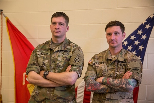 Army Sgt. Clinton Scanlon, left, stands next to Army Sgt. Bryce Fox, right, after graduating the Scout Sniper Course at Camp Geiger on Marine Corps Air Station New River, April 13. (Cpl. Madrigal/Marine Corps)