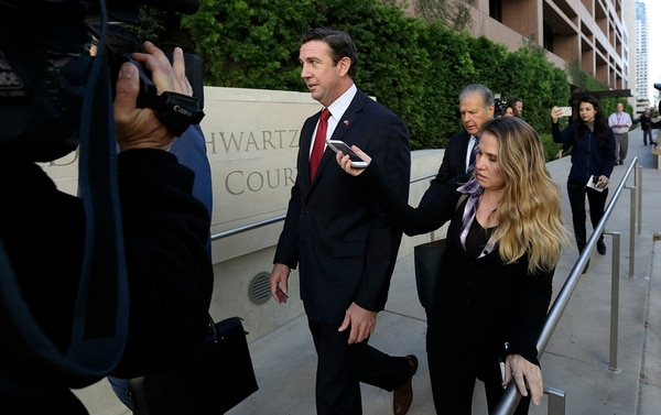 In this Dec. 3, 2018, file photo Republican Rep. Duncan Hunter, center, leaves court in San Diego. (Gregory Bull/AP)