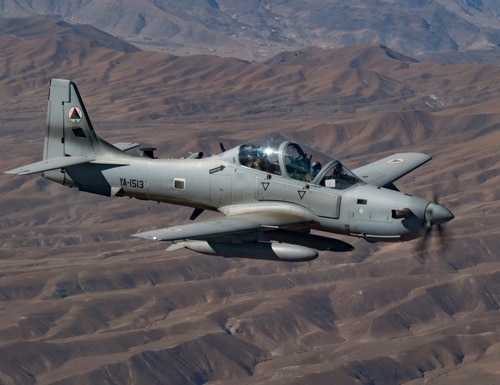 An Afghan pilot conducts training in an A-29 Super Tucano over Kabul, Afghanistan, as part of the Train Advise and Assist Command's (TAAC-Air) mission on Dec. 20, 2018. The final class of Afghan A-29 student pilots and maintainers to be trained by the 81st Fighter Wing at Moody Air Force Base graduated on Nov. 13. (Senior Airman Maygan Straight/Air Force)