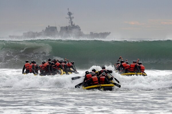 Basic Underwater Demolition/SEAL (BUDs) students participate in Surf Passage in 2014 at Naval Amphibious Base Coronado, Calif. (MC1 Michael Russell/Navy)