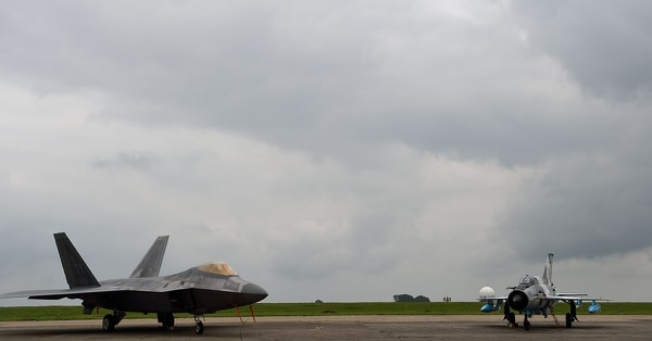 A U.S. Air Force F-22 Raptor, left, is parked next to a Romanian Army MIG 22-Lancer at the Mihail Kogalniceanu air base, near Constanta, Romania, in April 2016. (Daniel Mihailescu/AFP/Getty Images)