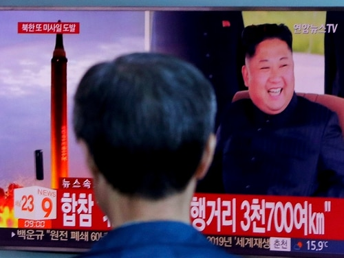 In this Sept. 15, 2017, file photo, a man watches a TV screen showing a file footage of North Korea's missile launch and North Korean leader Kim Jong Un, at the Seoul Railway Station in Seoul, South Korea. (Ahn Young-joon/AP)