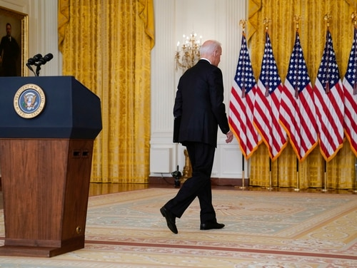 President Joe Biden walks from the podium after speaking about Afghanistan from the East Room of the White House on Aug. 16. (Evan Vucci/AP)