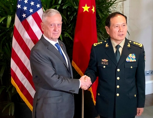 U.S. Defense Secretary Jim Mattis, left, meets Chinese Defense Minister Wei Fenghe in Singapore in October. Mattis and Secretary of State Mike Pompeo will meet Friday, Nov. 9 with their counterparts Fenghe and Yang Jiechi at the State Department. (AP Photo/Robert Burns, File)