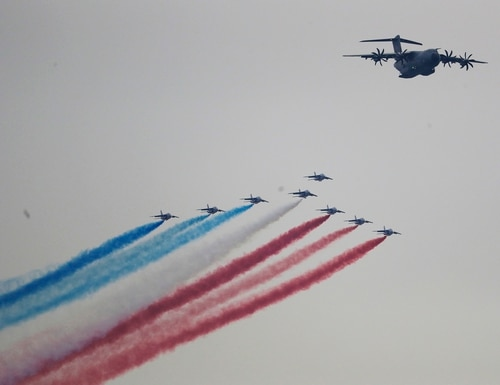 The French Air Force's Patrouille de France, led by an A400 Airbus support plane, performs a flyover Saturday, March 25, 2017, seen from Jersey City, N.J. The eight Alpha Jet formation is to commemorate the 100th anniversary of the United States entry into World War I and to reaffirm the historic ties between France and the United States. (AP Photo/Julio Cortez)