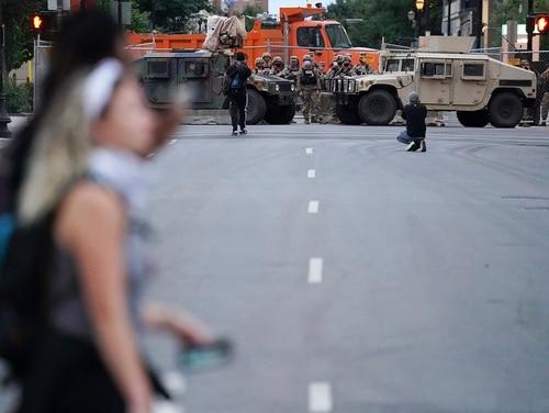 Members of the Kentucky National Guard watch people in the street, on Sept. 24, 2020, in Louisville, Ky. (John Minchillo/AP)