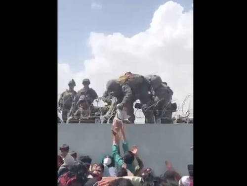 Marine Corps officials have confirmed that Marines with the 24th Marine Expeditionary Unit helped carry this infant over barbed wire to safety. (Screenshot)