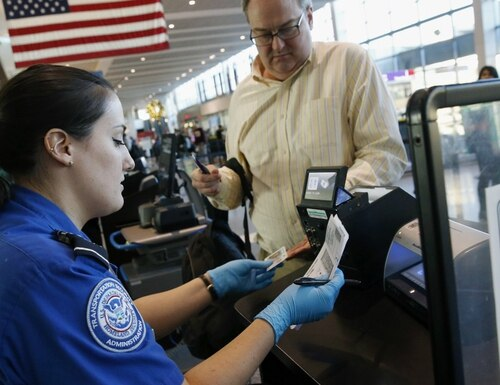 Transportation Security Administration personnel are compensated under unique pay bands that the House-passed legislation would do away with in favor of the standard federal compensation program. (Michael Dwyer/AP)